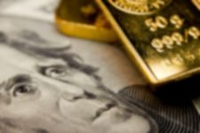 dollar bill and gold bars representing the evolution in monetary systems