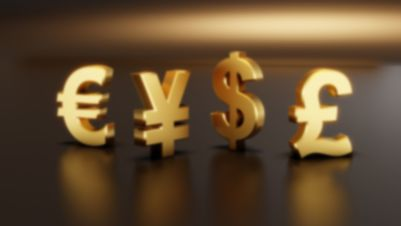Les principales monnaies fiduciaires mondiales, l'euro, le dollar, le yen et la livre sterling, plaquées en or.