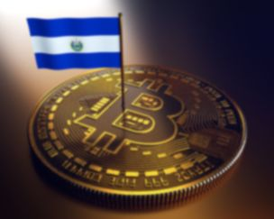 El Salvador flag put on top of a bitcoin coin after accepting bitcoin as legal tender
